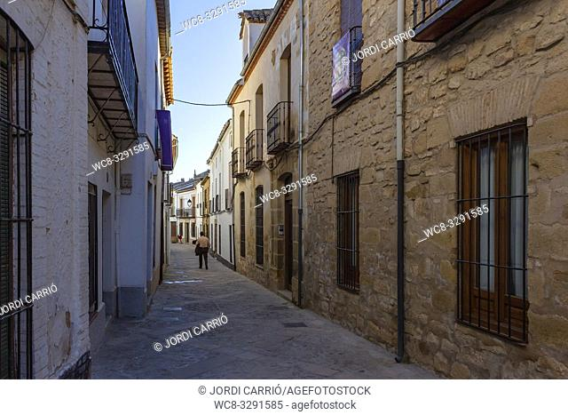 Baeza, Andalusia, Spain, March 2018: Street view of the historic center of the city of Baeza, where a man walks