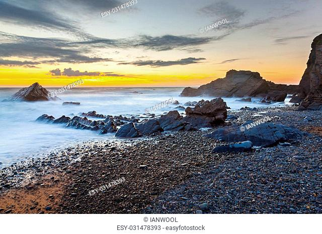 Dramtic sunset on the beach at Sandymouth near Bude North Cornwall England UK Europe