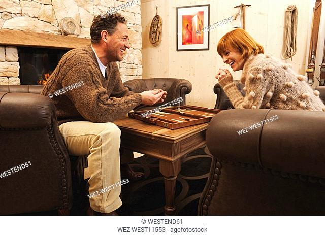 Couple playing backgammon, laughing