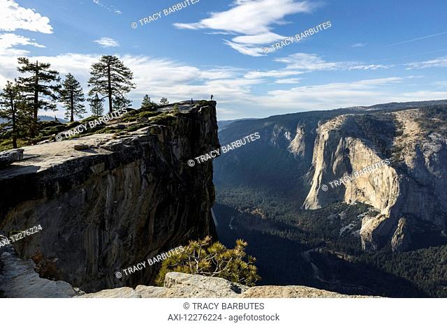 A Yosemite National Park visitor stands at Taft Point, which overlooks Yosemite Valley and El Capitan; California, United States of America