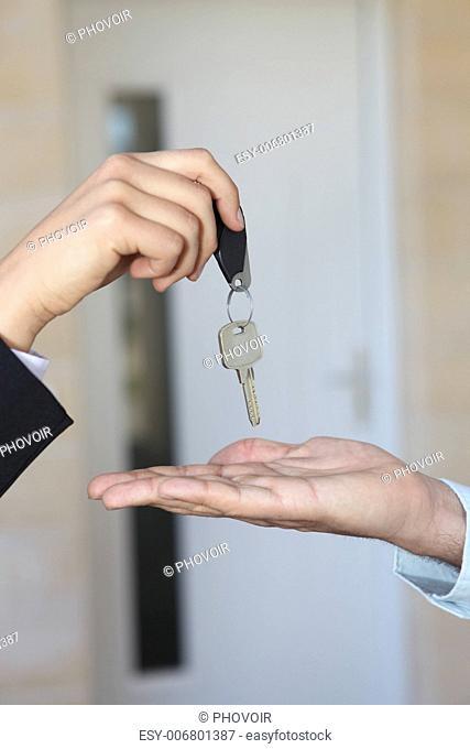 Estate-agent handing key to property