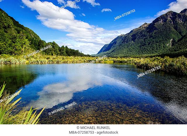 Mountains reflecting in the Mirror lakes, Eglington valley, South Island, New Zealand