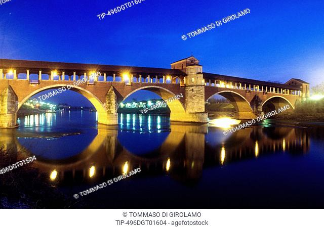 Italy, Lombardy, Pavia, covered bridge over the Ticino river at night