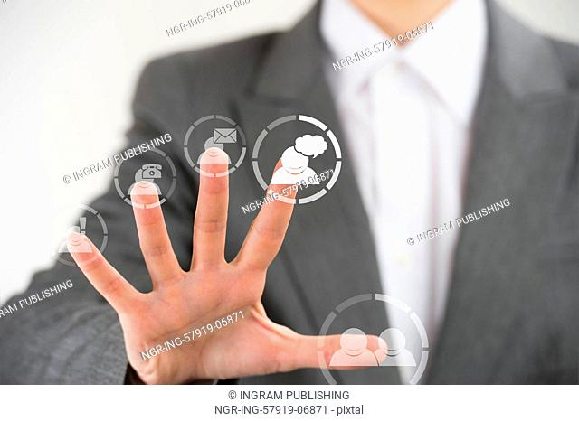 Business woman pointing her fingers on virtual web interface icons