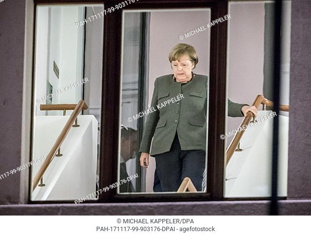 German Chancellor Angela Merkel walking in the building of the German Parliamentary Association between rounds of exploratory talks in Berlin, Germany