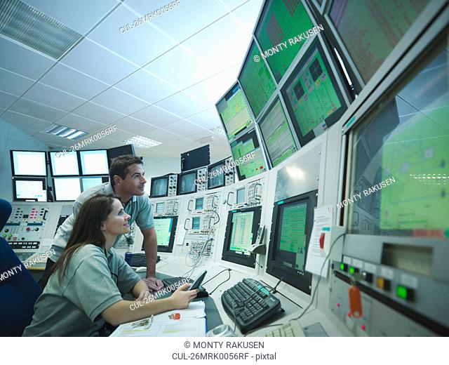 Scientists in accelerator control room