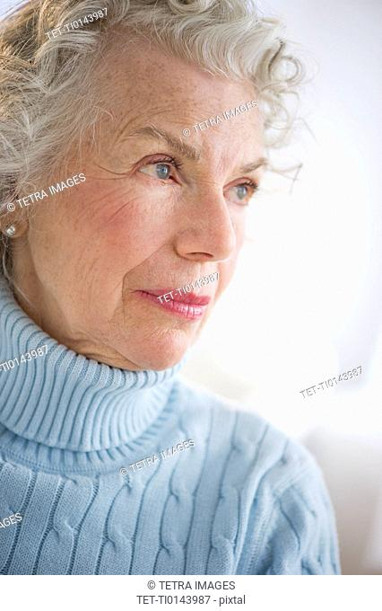 Pensive senior woman smiling