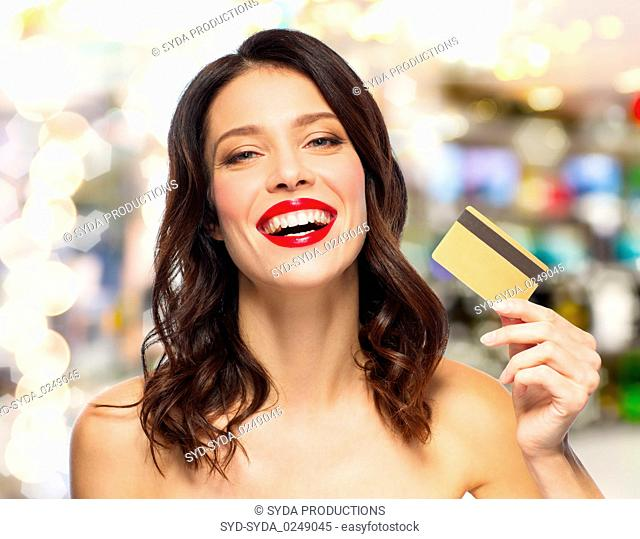 beautiful woman with red lipstick and credit card