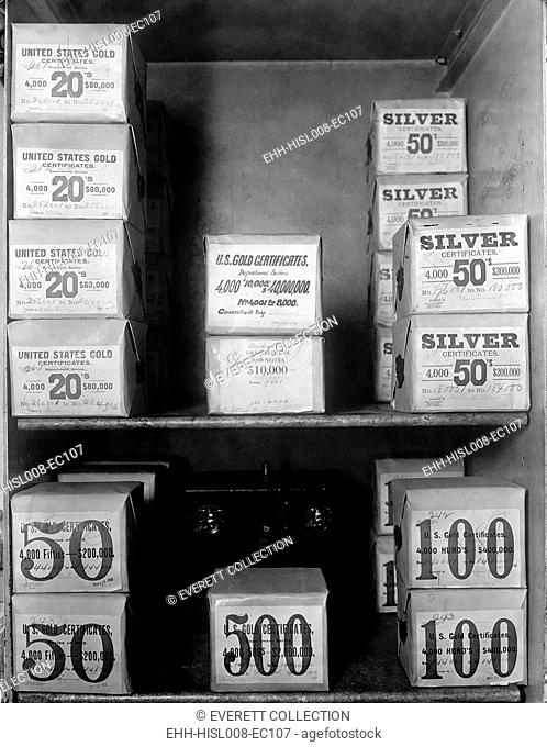 Cash vault of the United States Treasury holds packages of Gold and Silver certificates worth over 80 million dollars. In 1914, the U.S