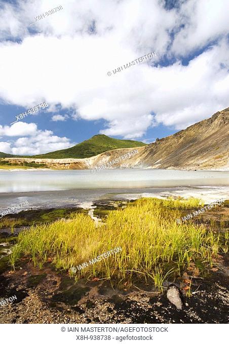 Lake in crater of Golovnino volcano on Kunashir Island in Kuril Island chain in Russia