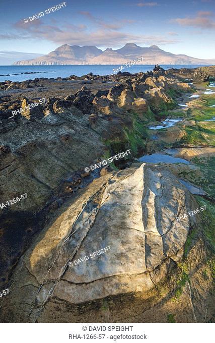 The Isle of Rum from Singing Sands on the Isle of Eigg, Small Isles, Inner Hebrides, Scottish Highlands, Scotland, United Kingdom, Europe