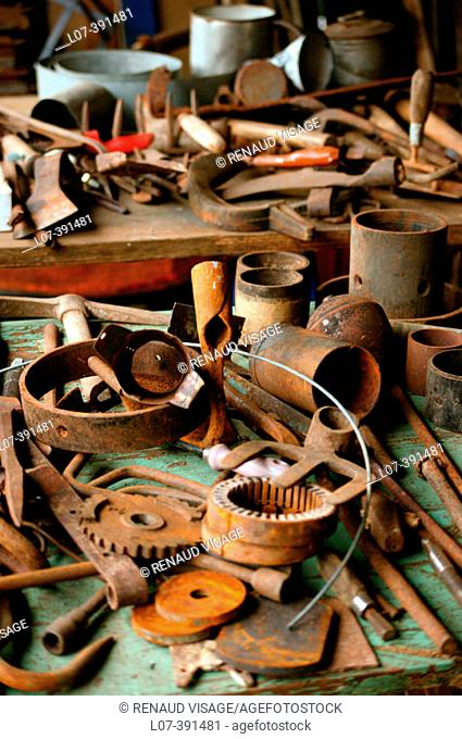 Old rusty cogs, wheels, and tools. Lurcy-Levis. France