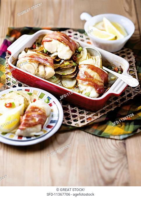 Hake fillet wrapped in bacon with potatoes