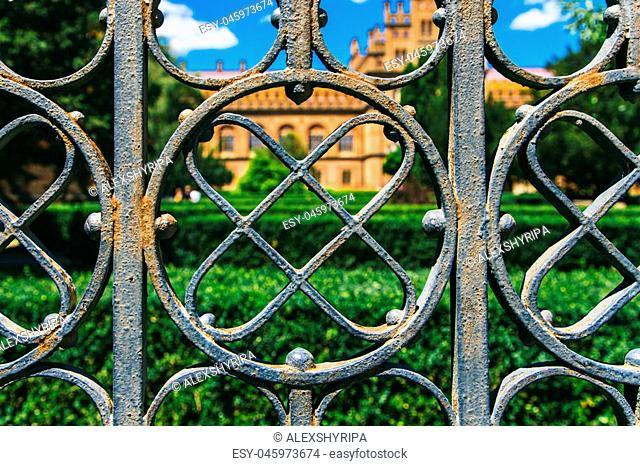 of the iron fence enclosing the park