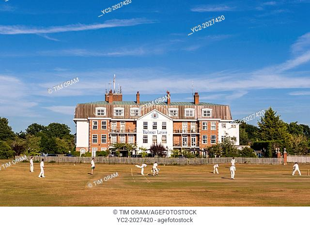 A cricket match takes place outside the Balmer lawn Hotel in Brockenhurst , Hampshire , England , Britain , Uk