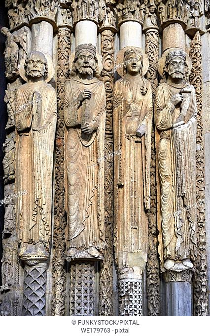 . West Facade, central Portal c. 1145, Cathedral of Notre Dame, Chartres, France. Gothic statues of four elongated human figures with halos
