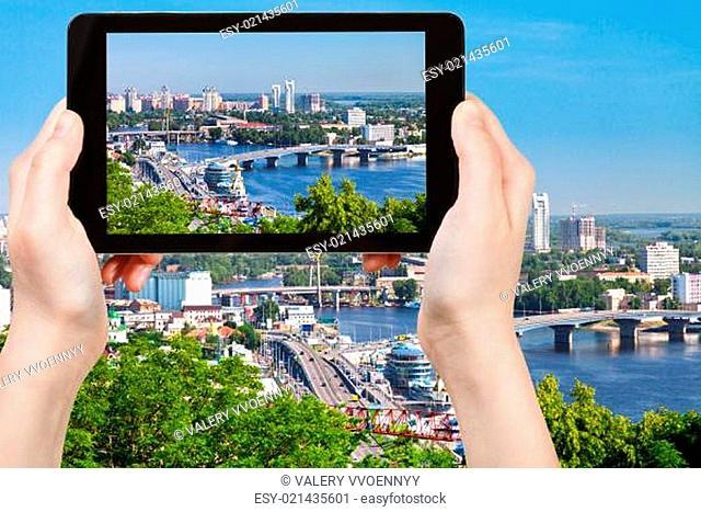 tourist taking photo of modern Kiev skyline