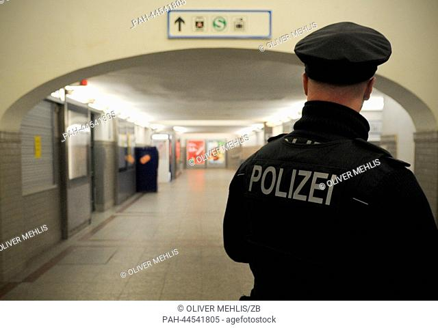 Police make sure the Oranienburg S-Bahn railway station is empty in Oranienburg,Germany, 04 December 2013. Around 12,000 people will have to be evacuated...