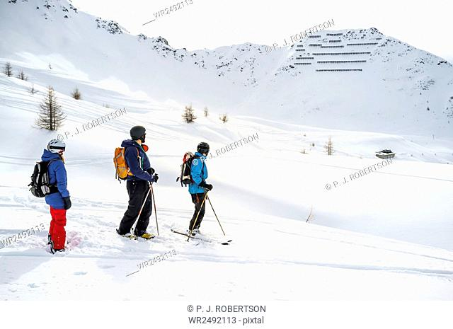 Group of snowboarders looking at winter scenery