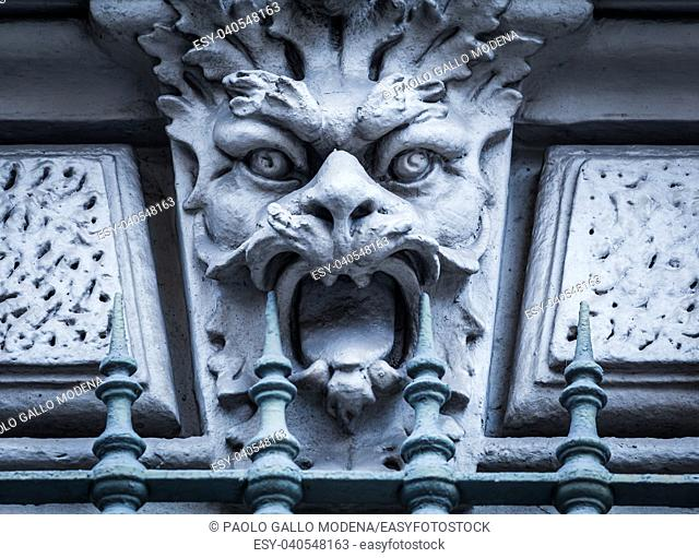 Italy, Turin. This city is famous to be a corner of two global magician triangles. This is a protective mask of stone on the top of a luxury palace entrance