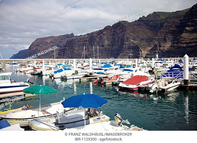 Harbour in front of Los Gigantes cliffs in Puerto de Santiago, Tenerife, Spain
