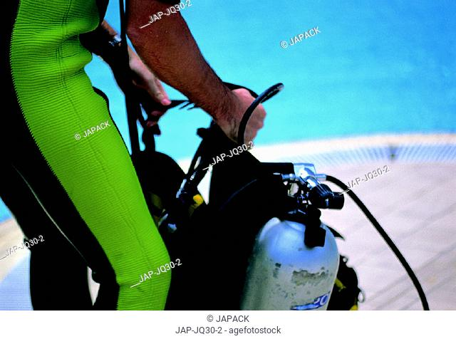 Scuba diver getting equipped
