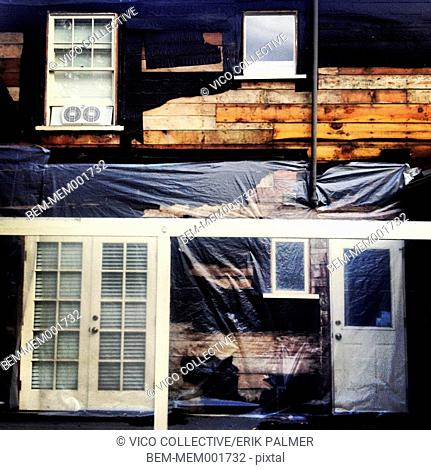 Plastic wrap siding of house under remodeling