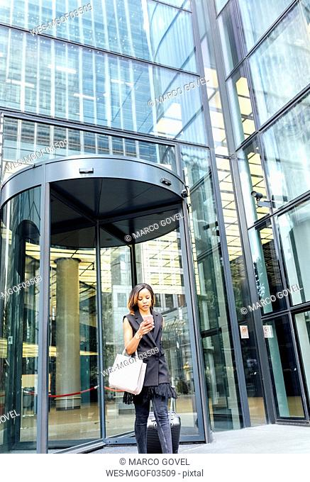 Businesswoman leaving an office building in the city