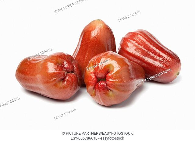 Whole fresh bell apples on white background