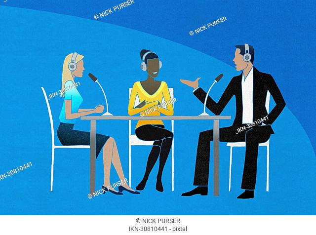 Two women and man having an interview