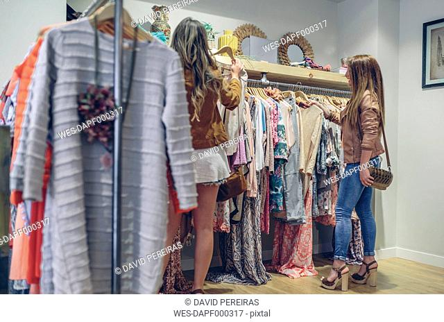 Two women shopping for clothes in a boutique