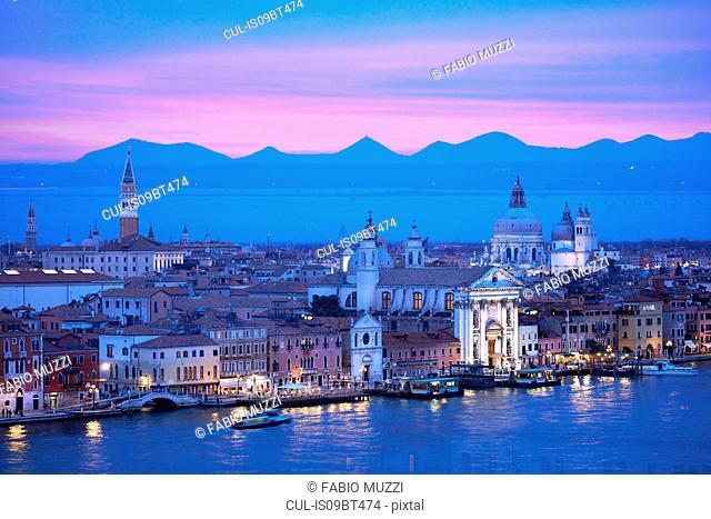Scenic cityscape over Giudecca canal at night, Venice, Veneto, Italy