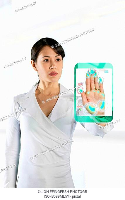 Woman holding hand up to recognition screen