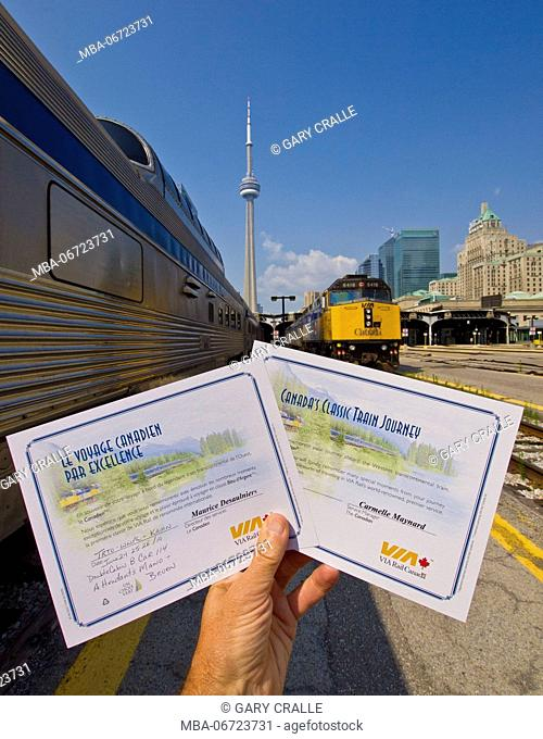hand holds Train certificates