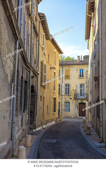 A narrow, but picturesque, street through the medieval city of Avignon in southern France