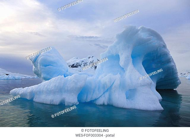 South Atlantic Ocean, Antarctica, Antarctic Peninsula, Gerlache Strait, Blue iceberg at paradise bay