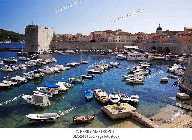 Small boats and yachts moored in the harbour of the old walled city of Dubrovnik; Dalmatia region, Croatia