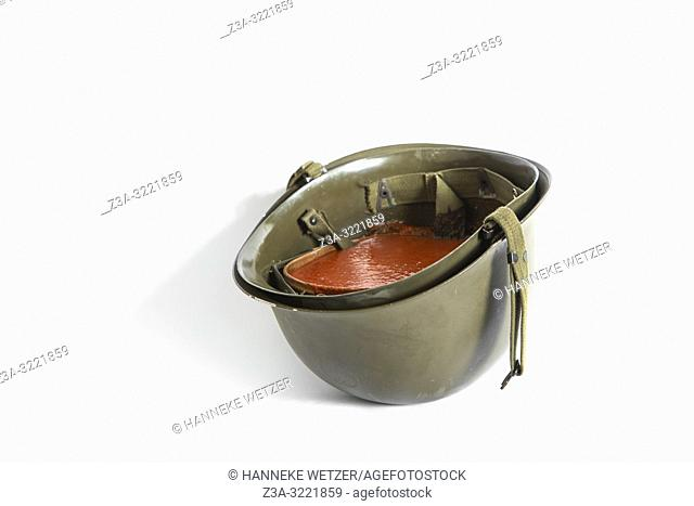 Soldier helmet filled with tomato soup
