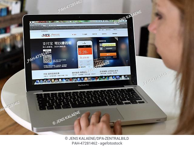 ILLUSTRATION - A young woman browses on her notebook computer through the web page of Chinese online money transfer and payment service provider Alipay in...