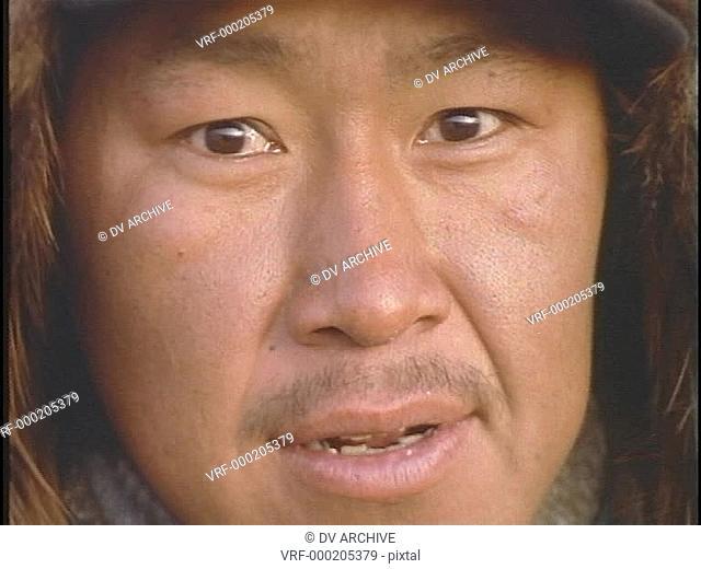 An Inuit Eskimo face looks forward