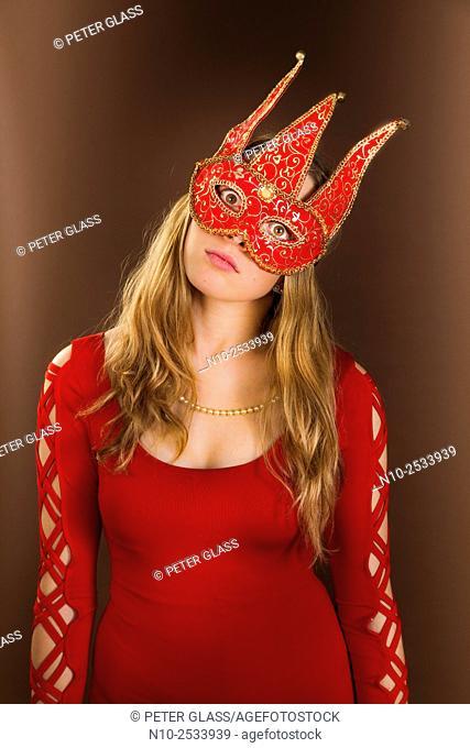 Blonde teenage girl wearing a mask