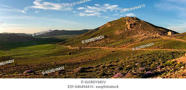 Moss covered highland valley in Middle Atlas mountain range in sunset, Morocco, Africa