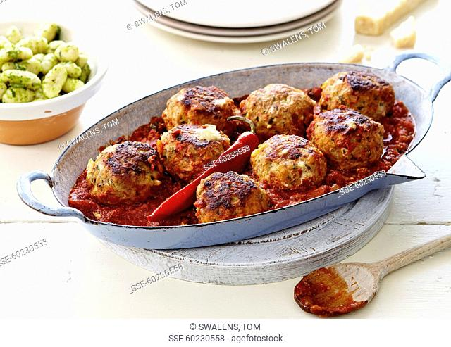Chicken meatballs with stewed red hot pepper tomatoes