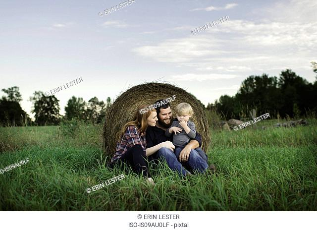 Portrait of young family in field