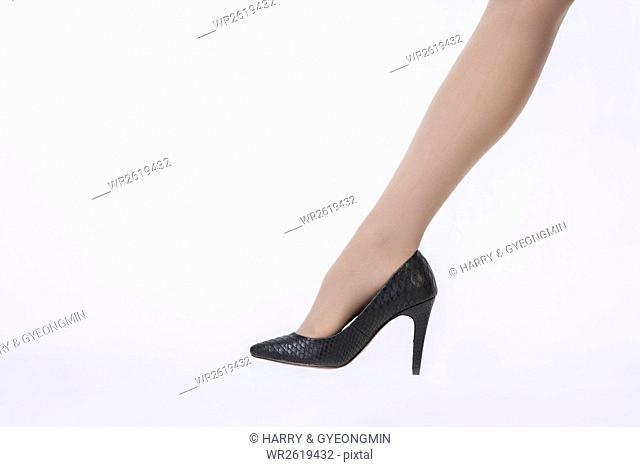 Leg in highheeled shoe