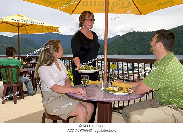 A couple dines at a restaurant near Powell river, on the upper Sunshine coast, Vancouver coast and mountain region of British Columbia, Canada