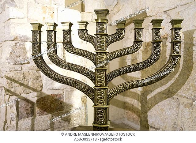 One of the holiest sites for Jews is the building on Mount Zion known as the Tomb of King David. Hanukkah menorah in King Davids Tomb