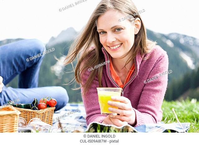 Portrait of mid adult woman picnicing with boyfriend, Wallberg, Tegernsee, Bavaria, Germany
