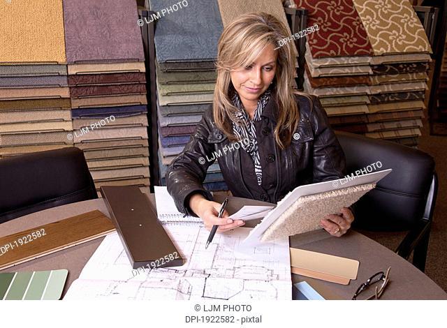 customer choosing floor coverings in a retail flooring store, edmonton, alberta, canada