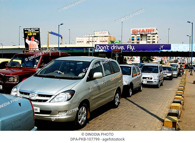 Traffic Jam in Bombay Street and Funny Ad  on the Top to Solve Problem Stating Do Not Drive but Fly ; Bombay Mumbai ; Maharashtra ; india